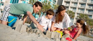 Myrtle Beach family on the beach (6 Reasons to Stay at a Resort in Myrtle Beach)
